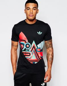 "T-shirt by adidas Originals Cotton jersey Crew neck Signature trefoil logo Mixed shape print Regular fit - true to size Machine wash 100% Cotton Our model wears a size Medium and is 178cm/5'10"" tall"