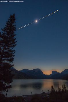 A Total Solar Eclipse over Wyoming, Image Credit & Copyright: Ben Cooper. Green River Lake, Wyoming, clouds blocked the Sun intermittently up to one minute before totality. Parting clouds then moved far enough away to allow the center image of the featured composite sequence to be taken. This image shows the corona of the Sun extending out past the central dark Moon that blocks our familiar Sun. The surrounding images show the partial phases of the solar eclipse both before and after…