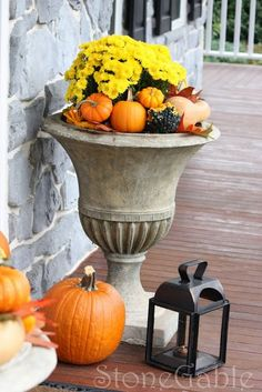Outdoor Fall Decor. Love the little pumpkins with the flowers