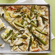 Win over any Easter crowd with this impressive asparagus recipe that takes just 20 minutes to make. Simply spread the Parmesan sauce on purchased pizza dough before topping with fresh asparagus, yellow squash, and garlic.