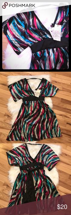 NWT Guess short sleeve Mini dress NWT Guess mini dress. Black dress with pink, blue and white pattern. Black band around middle with tie in back. Zipper on side. She'll 97% polyester 3% spandex. Great for parties or a night out!  The dress is a size 3 Guess Dresses Mini