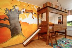 """How adorable is this Calvin and Hobbes themed kid's bedroom? This sweet space was made in Finland by redditor pellari with the help of his sister. The mural was painted free-hand using an original Calvin & Hobbs drawing as inspiration and that bunk bed you see? It was made using a second hand bed which already came with a slide. They added in the wood laminate and wooden planks to add more of an authentic feel to the whole theme. Well, I think they officially win """"Dad of the Year"""" and """"Au..."""