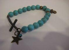 Pulsera bolas turquesas con cruz y estrella