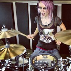 Making a stupid drum face.  Shot from a Little Talks, Of Monsters and Men drum cover.  Rocking the pink hair and the Vic Firth sticks.  http://www.youtube.com/marivoilesdrumming