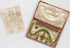 Set of peridot jewelry given by Prince Regent to Miss Charlotte Cotes in thanks for attending his daughter, Princess Charlotte of Wales, before her marriage, 1816. Rundell, Bridge & Rundell. Victoria and Albert Museum. More info: http://twonerdyhistorygirls.blogspot.com/2013/06/the-prince-regent-rewards-loyalty-with.html