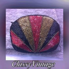 Beautifully beaded makeup bag Beautifully beaded small makeup bag. Beaded shell design and shape. Substantial . It's a firm little bag. Satin interior.black - gold and red in color boutique Bags