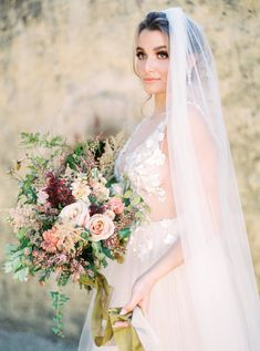 Bride wearing romantic wedding dress featuring intricate floral embroidery and tulle skirt. She carries a textured wedding bouquet with blush and burgundy flowers tied with gold silk ribbon. Second Wedding Dresses, Wedding Gowns, Brides Cake, Fairytale Weddings, Wedding Photography And Videography, French Wedding, Wedding Bouquets, Wedding Flowers, Wedding Inspiration