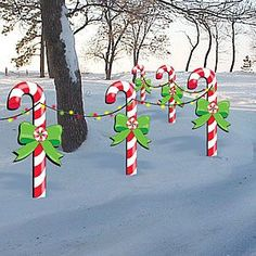 "Candy Canes Pattern:  Line your entire yard or drive with these colorful candy canes and welcome your guests this holiday season. 48""H x 23""W Pattern #2286  $10.95   ( crafting, crafts, woodcraft, pattern, woodworking, yard art ) Pattern by Sherwood Creations"