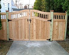 wood pergola with semi private wood fence by elyria fence