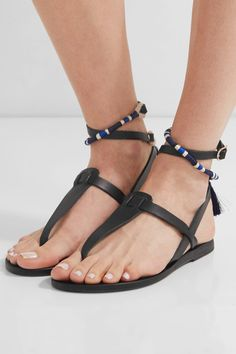 Heel measures approximately 10mm/ 0.5 inches Black leather Buckle-fastening ankle strap Imported