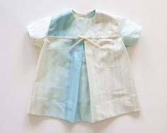 A spring baby dress, from Whitney Deal.  (Not for sale, alas, but darling.)