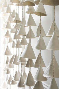 Mud Puppy wind chimes via Etsy | Remodelista wall of ceramic wind chimes from Austin, Texas, artist Jennifer Pritchard