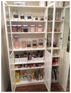 IKEA Hack- Billy Bookcase as Pantry Storage- has glass doors on top solid on the bottom for the best of both worlds. Love this so much!