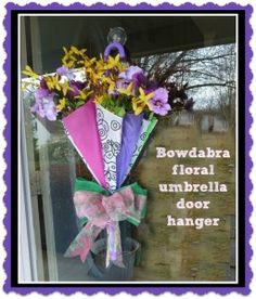 Bowdabra Floral Umbrella Door Hanger.!! What better way to decorate for spring than with a cool floral umbrella door hanger? #DIY #Crafts #SpringCrafts