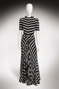 White and black zigzag print 1930s Lanvin dress. I would turn this into a top and skirt and shorten it. Wear either as separates or together. Dressed down with flat sandals in the summer or up with high heeled strappy sandals.