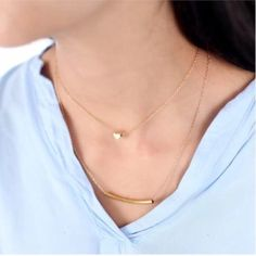 Gold plated layering necklace with a heart charm New, never worn. Stunning gold plated layering necklace with a heart charm necklace. Thank you for visiting my closet, please let me know if you have any questions, I offer great discounts on bundles :) Boutique Jewelry Necklaces