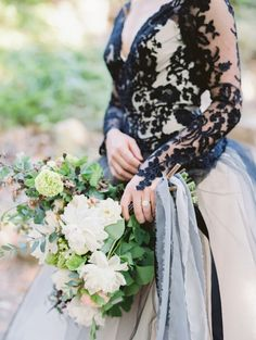For an elegant Halloween wedding you don't have to go full-on Morticia Addams. This wedding dress features a black lace bodice that is unconventional, but divine. She also used a tattered ribbon for her bouquet. Tiny details like this will add to your wedding's theme, without turning it into a Halloween carnival.