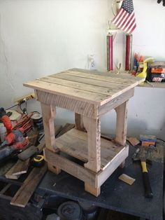 Make your own pallet end table - Wooden Pallet Furniture. Maybe a bar height one. The only way I'll get a new table.