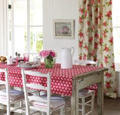 Combine painted vintage chairs and a rustic table with simple floral textiles for a cheery dining room.