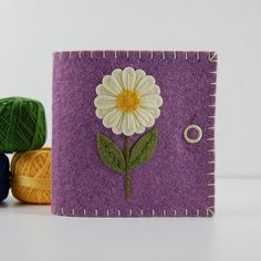 """Purple Wool Felt Needle Book / Sewing Needle Case / Hand Embroidered / Ivory & Gold Daisy $20.00 Size: 4"""" x 3 3/4"""" (10.2 cm x 9.5 cm) when closed."""