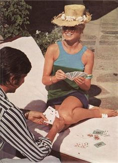 Brigitte Bardot and Gunter Sachs playing cards on their honeymoon in Tahiti, 1966.