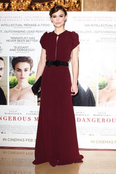 Keira Knightley (January 2012): for London premiere of A Dangerous Method, star went for minimal-chic look in oxblood Burberry Prorsum pre-fall 2012 gown w/ black bow accent at waist