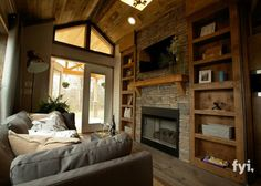 Tiny House Living Room has a big, dramatic stone fireplace and mantle, big wooden built-in cabinets, big stunning entryway, and a big feeling of space. Tiny House Movement, Tiny House Living, Small Living, Living Area, Living Rooms, Apartment Living, Dorm Rooms, Tiny House Nation, Built In Cabinets