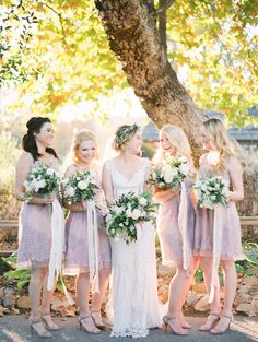 purple bridesmaid dresses - photo by Mallory Dawn Photography http://ruffledblog.com/high-school-sweetheart-wedding-in-california