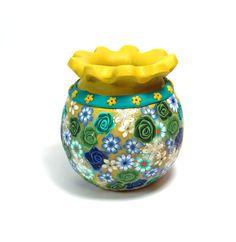 Floral clay vessel each one unique clay vase