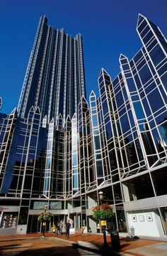 """On April 11, 1984, PPG Place was dedicated as new world headquarters of PPG Industries. Architectural critics & media called it """"the crown jewel in Pittsburgh's skyline,"""" """"the towering success of downtown Pittsburgh,"""" and """"one of the most ambitious, sensitive and public spirited urban developments since Rockefeller Center."""" Includes 6 buildings, covers 5.5 acres & consists of 19,750 pieces of glass. Cost of construction was approximately $200 million ($452 million today)."""