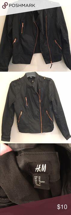 Moto jacket Women's moto jacket . Black with gold zippers . Heavy, jean like material H&M Jackets & Coats