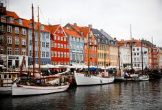 """Copenhagen, Denmark.  It's home to the happiest people in the world, so expect to see a lot of smiles. Also, expect beer for lunch. In terms of sites, you'd be a fool not to walk the beautiful canals, or to visit the self-governing """"free town"""" of Christiania where soft drugs are enjoyed freely and artists and hippies compete for your attention in the shops and colorful bazaar. That there is a daily ferry to Oslo is a bonus."""