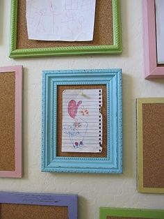 Frames filled with cork board for kids artwork and writings- instead of pinning on fridge, hang on the wall and have constant changing wall art! SMART!