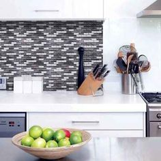 Update your kitchen backsplash by using 3D gel-like tiles that are actually peel and stick.
