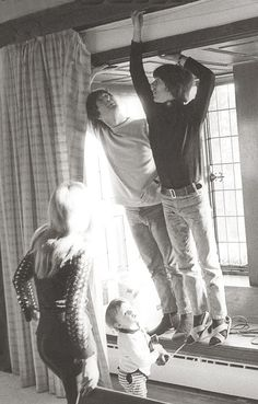 1965 - Cynthia Powell, Julian Lennon, John Lennon and George Harrison.