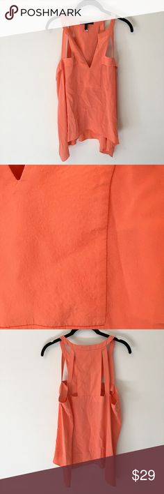 BCBGMaxAzria Orange Silk Cut Out Sleeveless Shirt BCBGMaxAzria orange shirt made from silk that has cut out Detail along the top shoulders- size medium and has some slight silk detail due to it getting wet that is shown in photo above. Not super noticeable from far away. Looks like a slight crinkle. Very beautiful color. Price adjusted for minor imperfections! BCBGMaxAzria Tops Blouses