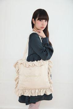フリルのピローバッグ。Ruffle Pillow Bag with small pocket on the inside and reads goodnight. This would be perfect with long full boho ruffle broomstick skirt, lightweight ruffle top, two Ariel mermaid braids, and Tokyo Bopper boots