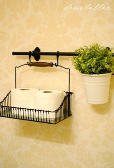 Got a small bath with no storage? Use baskets hanging from a towel bar to store extra paper, hand towels, etc.