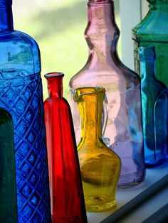 Colorful bottles look so pretty in a window with the sunlight streaming through.