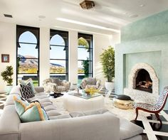 Moroccan Style! What stunning windows, and beautiful fireplace