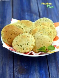 Dough pepped up with myriad ingredients like mint leaves, cumin seeds and lemon juice, gives rise to tasty and aromatic puris that are so flavourful Puri Recipes, Paratha Recipes, Veg Recipes, Indian Food Recipes, Vegetarian Recipes, Cooking Recipes, Ethnic Recipes, Mint Recipes, Indian Snacks