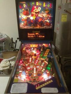 Mario Brothers Pin Ball machine. This would be perfect for the game room! Saw it on Craigs.