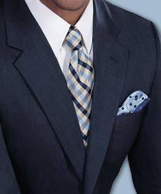 Striped tie with polka dot pocket square gives the right touch of colors with a serious navy blue suit.