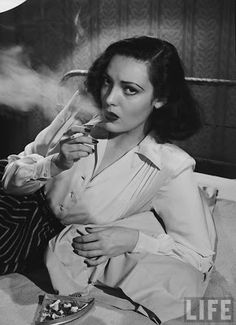 40s vintage fashion white rayon blouse button front long sleeves simple striped skirt movie star model photo print ad film noir style vintage Linda Darnell