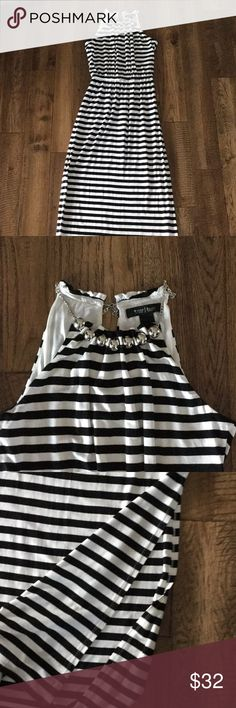 NEW LISTING! Black and White Maxi Dress EXC COND Black and white striped maxi dress. Looks very cute with a wide black belt. I have 2 listed in my closet. Wear with shrug or jean jacket in cooler weather. Excellent condition. White House Black Market Dresses Maxi
