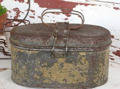 An antique lunch box pail...unbelievable patina!  Don't ya just love it?!!!  Wonder what kind of lunches it carried....
