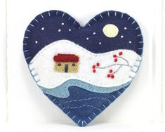 A handmade felt Christmas heart ornament, embroidered with a traditional Irish cottage in a snowy winter landscape, under a full moon and starry night sky. The heart measures approx. 4 inches / 10cm across, and has a cotton loop for hanging. You can see other variations on this design with my other felt heart ornaments here; https://www.etsy.com/ie/shop/PuffinPatchwork?ref=l2-shopheader-name&section_id=19324374