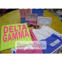 Delta Gamma Bid Day Packages available today in stores or online! Bid Day Gifts, Delta Gamma, Brown Bags, Online Gifts, Sorority, Beach Mat, Outdoor Blanket, Packaging, Paper Bags
