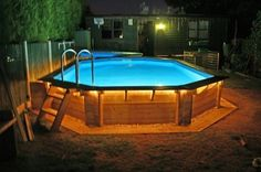 above ground pools - why didn't I think of rope lighting around the pool?!?! gonna have to try it!!