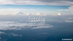 "Download the royalty-free photo ""The beautiful cloudy and blue sky at early in the evening (view from airplane)."" created by phasuthorn at the lowest price on Fotolia.com. Browse our cheap image bank online to find the perfect stock photo for your marketing projects!"